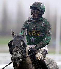 A very muddy Sam Twiston-Davies riding Pigeon Island return after pulling up at Cheltenham racecourse in Cheltenham, England