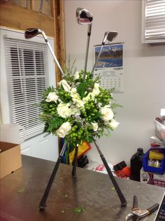 Tribute flowers using golf clubs.