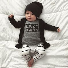How good are lazy days at home?! This is one of my all time fave pics! Knoxie wearing our Panther Bandit Beanie  Signature Jet Black cardi which have just been restocked in ALL sizes from 3-6m - size 8! Available online now - along with 10 other colours to choose from! www.beauhudson.co