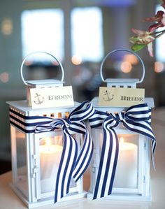Mini lanterns. So cute and lots of wedding decoration vendor websites carry them!