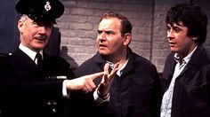 "Mackay (Fulton Mackay), Fletcher (Ronnie Barker) and Godber (Richard Beckinsale) in 'Porridge'.   Sir David Attenborough says ""It entertained and educated, gave you insight into psychology and current affairs, and was the greatest programme we've ever seen,"""