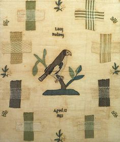 early 19th century darning sampler with decorative bird centre motif by Lucy Pudney worked in 1823