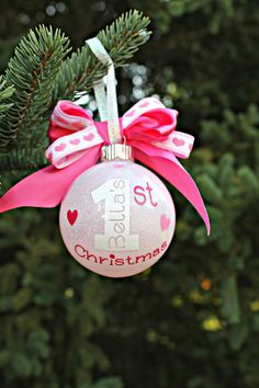 In note to seller please include: 1. Name 2. 3 decal colors ( Shown: White, Soft Pink, Hot Pink ) 3. Year Welcome that new baby to the family with this totally Adorable ornament. The ornament measures approx. 70mm in diameter. The quote states (names ) 1st Christmas with random