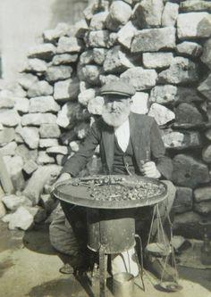 STREET SELLER. Istanbul street vendor, selling roasted 'kestane' (sweet chestnut) 1920.