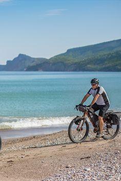 Enjoy a ride on the beach with a fatbike! Whether you are enthusiastic about family biking, bicycle touring, cyclosports, mountain biking, or fatbikes, the Gaspésie has a route for you! Photo: CHOK Images Fat Bike, Mountain Biking, Touring, Photos, Bicycle, Unique, Beach, The Beach, Bicycle Kick