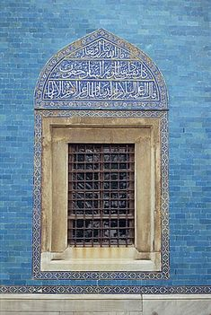 Detail of window with Arabic script on tilework above, in the Green Mosque in Bursa, Anatolia, Turkey