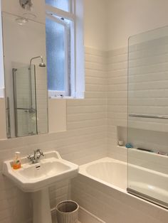 Original fixtures & fittings with white tiles create vintage chic