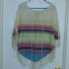 NWOT Billabong Rainbow Poncho Pretty,  comfy, light, flowy, this poncho rocks.  Bought while on vacation and never wore; been sitting in my closet ever since.  Never worn or washed; perfect condition.  Great for spring and summer,  or colder weather over a fitted long sleeve.  Will fit S, M, or L.  NO TRADES, PPAL,  OR LOWBALL OFFERS. Billabong Sweaters Shrugs & Ponchos
