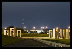Bonfire Memorial on the Texas A&M Campus wide view, at night.