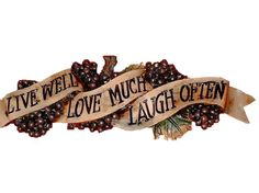 This plaque features clusters of grapes around a banner that has an inspirational message Live Well Love Much Laugh Often. $24.95