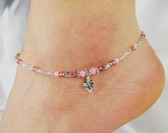 Rose gold triple dangle cluster beaded anklet, ankle bracelet made with Swarovski crystals, Czech glass beads and pearls, and Czech glass seed beads. ~ Triple dangle cluster focal ~ Gold luster-coated watermelon pink Czech glass donuts ~ Gold Czech glass pearls ~ Watermelon pink Swarovski crystals ~ Matte metallic gold Czech glass seed beads with pink accents ~ All metal beads are lead/cadmium-free Tibetan silver; clasp and other finishing-off pieces are silver-plated ~ Strung on strong...