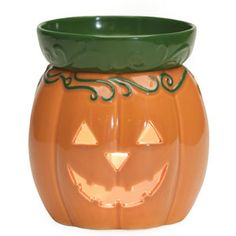 Jack O' Lantern Full-Size Scentsy Warmer    Jack O' Lantern's toothy grin is sure to enhance even the spookiest fall décor. This glossy orange pumpkin is topped by a leafy green dish.