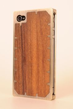 Brass and wood phone case.  I love when people make new technology look antique. It makes me feel like I'm in some sort of steam punk novel.