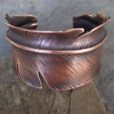 Fold forged feather arm band