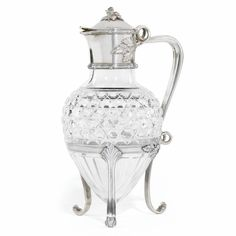 A Fabergé silver-mounted cut glass decanter, Moscow, circa 1890, amphora form, the cylindrical collar within bound reeds, cast and chased foliate finial, leaf scroll handle, tripod stand.