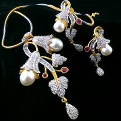 Pearl Leaf Ruby American Diamond Gold Plated Chain Pendant Earring Set  *Beautifully hand crafted *Pendant and Earrings *Sparkles like real diamond *gold necklace *High quality American *Diamonds are used *Big size earrings and pendant *Gold plated pendant set   ₹1,399.00 INR  To Buy  http://crazyberry.in/online-shopping/artificial-imitation-fashion-jewellery/pearl-leaf-ruby-american-diamond-gold-plated-chain-pendant-earring-set