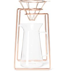<a href='http://www.mrporter.com/mens/Designers/Toast_Living'>Toast Living</a>'s carafe set is for coffee connoisseurs who take their morning cup seriously. The copper-tone dripper stand holds the filter in place and the heat-resistant glass canister will keep a brew hot while you go about your morning routine. The minimalist design will make a stylish addition to any counter top.