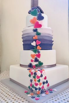 A stunning four tiered ruffle fondant cake, complete with cascading hearts and biscuit toppers! Ruffle Cake, Favours, Cake Ideas, Biscuit, Fondant, Special Occasion, Wedding Cakes, Hearts, Deco