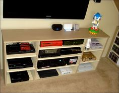 The shelves on the cabinet unit can be slid out to vent the consoles, and to dust easily. Wires are secured and labeled behind the unit. I would add cabinet doors that lock and wheels and additional storage for baskets to keep games and controllers for each system.