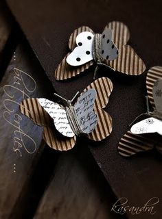 Butterflies cut from corrugated cardboard, jute wrapped around for body and tied for antennae