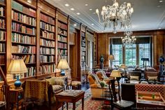 This library in the Crespi/Hicks Estate is finished with the 19th century Italian carved walnut and burl from the library of a private Palazzo in Bologna, Italy.