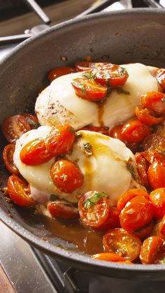 Caprese Chicken: easy, delicious, chicken (breast, thigh), garlic, olive oil, balsamic, basil, tomatoes, mozzarella. Awesome!