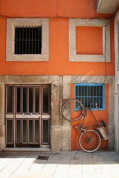 Bicycle in front of an orange house, Barcelona, Spain #bike #bicycle