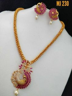 Jewelry OFF! Beautiful one gram gold hallow gajar chain with dancing peacock pendant. Peandant studded with white and pink color stones and pearl hangigns. Ruby Necklace Designs, Jewelry Design Earrings, Gold Jewellery Design, Jewellery Box, Diamond Jewellery, Jewelry Holder, Jewelry Sets, Gold Necklace Simple, Gold Jewelry Simple