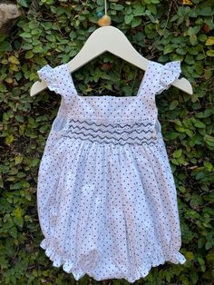 This adorable set of cotton smocked rompers has the top adorned with a stripe of smocking that matches the colour of the polka on the dress. The sleeveless polka-dotted rompers have frilly shoulder straps and elasticated legs that make the leg movement look easy peasy. Easy Peasy, Cotton Dresses, Shoulder Straps, Smocking, Rompers, Legs, Colour, Collection, Color