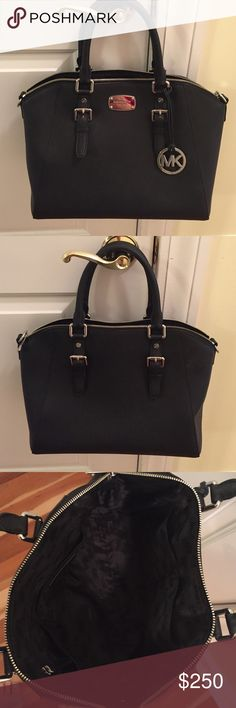 Michael Kors bag Beautiful black bag in great condition. Not as stiff as it used to be. Price is firm!! Michael Kors Bags