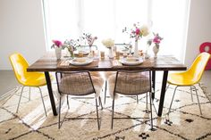 Mix colors and chair patterns to give a colorful touch to your dining room. Birds Of A Feather Get Together Brunch | theglitterguide.com