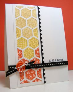 handmade card for colourQ challenge #161... column of hexagons cut from tiny  pattern papers in yellow and orange ... black ribbon and zig zag border ... bright and cheerful ...