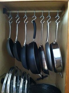 26 Pan Organizer to Maximize your DIY Cabinet Space Hanging. Timmins & Associates pattisonjude cupboard organization 26 Pan Organizer to Maximize your DIY Cabinet Space Hanging pots and pans is a fantastic Kitchen Cupboard Organization, Pan Organization, Kitchen Pantry Design, Diy Kitchen Storage, Kitchen Cupboards, Modern Kitchen Design, Home Decor Kitchen, Kitchen Furniture, Kitchen Interior