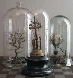 Dome love    or Cloche (sp?)  I have a live plant under on sitting a top of a cake pedestal and a bridal topper looks sweet too