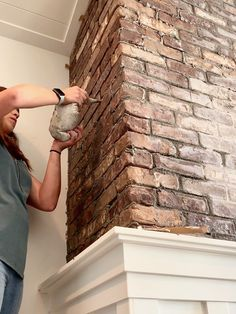 Full tutorial on how to install thin brick veneer on a fireplace wall. Includes tips and tricks to cut thin brick veneer as well as adhere, space, and grout. Black Brick Wall, Brick Accent Walls, Faux Brick Walls, Brick Tiles, Brick Flooring, Exposed Brick Walls, Thin Brick Veneer, Brick Veneer Wall, Bricks