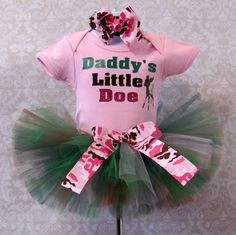 Daddy's little girl will definitely have him wrapped around her little finger in this outfit. Our Daddy's Little Doe outfit includes the hairbow, onesie/t-shirt, and the tutu with a removable bow on the waistband. This outfit would be perfect as a baby shower gift, Fathers Day pictures, birthday parties and so much more. For sizes 0 - 24 months the outfit will come with a onesie and sizes 2T and up will include a t-shirt. . A headband will be made for sizes 0-2 and a hair clip for sizes ...