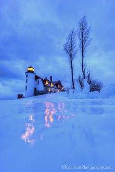 Point Betsie Lighthouse -- Michigan; what a great place to slide at twilight, with the lights glistening on the icy snow-cover!! ... <3<3<3<3<3