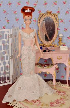 Fully lined, fitted gown with wrap bodice, empire waist, and long mermaid skirt. Dress is sewn entirely by hand from an exquisite vintage, hand-embroidered wedding hankie with white stitching on a white background. Dress is lined in blush pink and fastened with metal snaps. Hand embroidery absolutely covers the entire gown. Includes rhinestone ring tiara.  This fashion is specially made to fit: - Silkstone Barbie - Victoire Roux - Fashion Royalty Color Infusion - Poppy Parker - and similar…