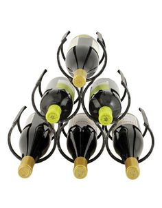 Wine Shrine Bottle Rack for $27.50 from WineRacks.com  Made from strong, but lightweight metal, the Wine Shrine is a stylish and secure six bottle rack. Its industrial finish complements any interior decor.      Holds six bottles     Painted metal construction