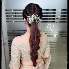 Bridesmaids can use these pretty blooms to glam up their sleep pony hairstyles too. - Education and lifestyle Bridal Hairstyle Indian Wedding, Bridal Hair Buns, Bridal Hairdo, Bridal Braids, Hairdo Wedding, Indian Bridal Hairstyles, Braided Hairstyles For Wedding, Elegant Hairstyles, Bridal Hair And Makeup