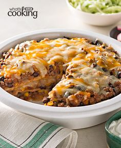 Enchiladas anyone? Ground beef, salsa, corn, black beans and cheese are layered between tortillas for an enchilada bake recipe that's like a fiesta in a dish. Ground Beef Dishes, Ground Beef Recipes, Mexican Food Recipes, Vegetarian Recipes, Cooking Recipes, Oven Recipes, Meal Recipes, Mexican Dishes, Chicken Recipes
