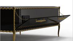 IVY - Though simplistic in its form, Ivy is far from being simple. Coils of golden rope are wrapped along the edges, giving away to the translucent outline.  #coffeetable #blackcoffeetable #glasscoffeetable http://www.bykoket.com/guilty-pleasures/casegoods/ivy-coffee-table.php