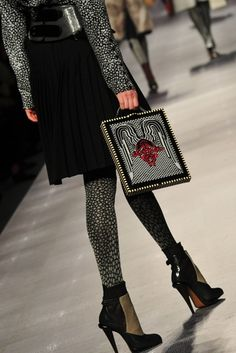 wow, crazy devil motif on the bag.  A little too devilish for me, but I love the combination of the tights, skirt and those shoes.  All the shoes are amazing in this show.  Fendi.