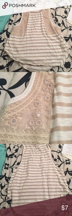 Free People Tank Great condition! Size XS but fits loose... more like a small in my opinion! Very relaxed fit! The embellishments on the top are reflective! From smoke free home. Free People Tops Tank Tops