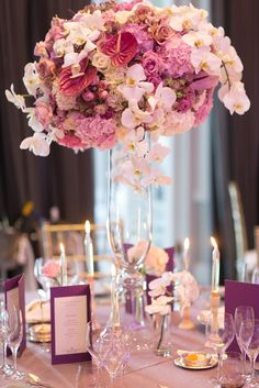 Mass floral arrangement, purple and white with Gold. Orchids and roses Luxury Wedding Reception flowers with Candle light Grey