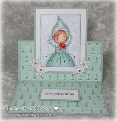 Sugar Nellie—Poinsettia Girl, a digi available at Funky Kits, made into an easel card.  So cute!