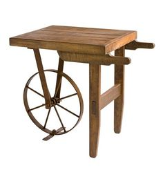 "Distressed Wood Wheelbarrow SideTable. Crafted of rough-hewn wood and cast iron, with an authentic-looking wheel and distressed finish. Heavy-weight table, generously sized to make a statement. 25.5""L x 16""W x 22""H"
