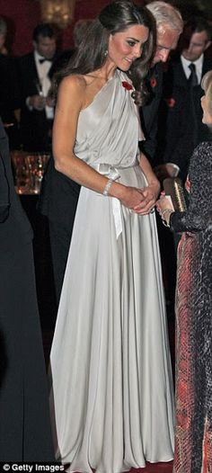 Kate wore a silver chiffon satin asymmetric go Jenny Packham designed dress