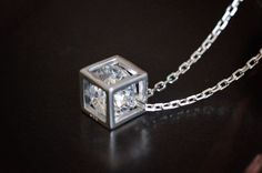 Crystal Cube Necklace - sterling silver - This necklace is on a dainty sterling silver square link chain, with a genus cutting cubic zirconia