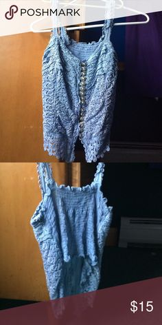 Button down crop top My mother purchased this when she was on a trip I'm not positive where it was purchased. No size tag but deffinitley fits as a small. Tops Crop Tops